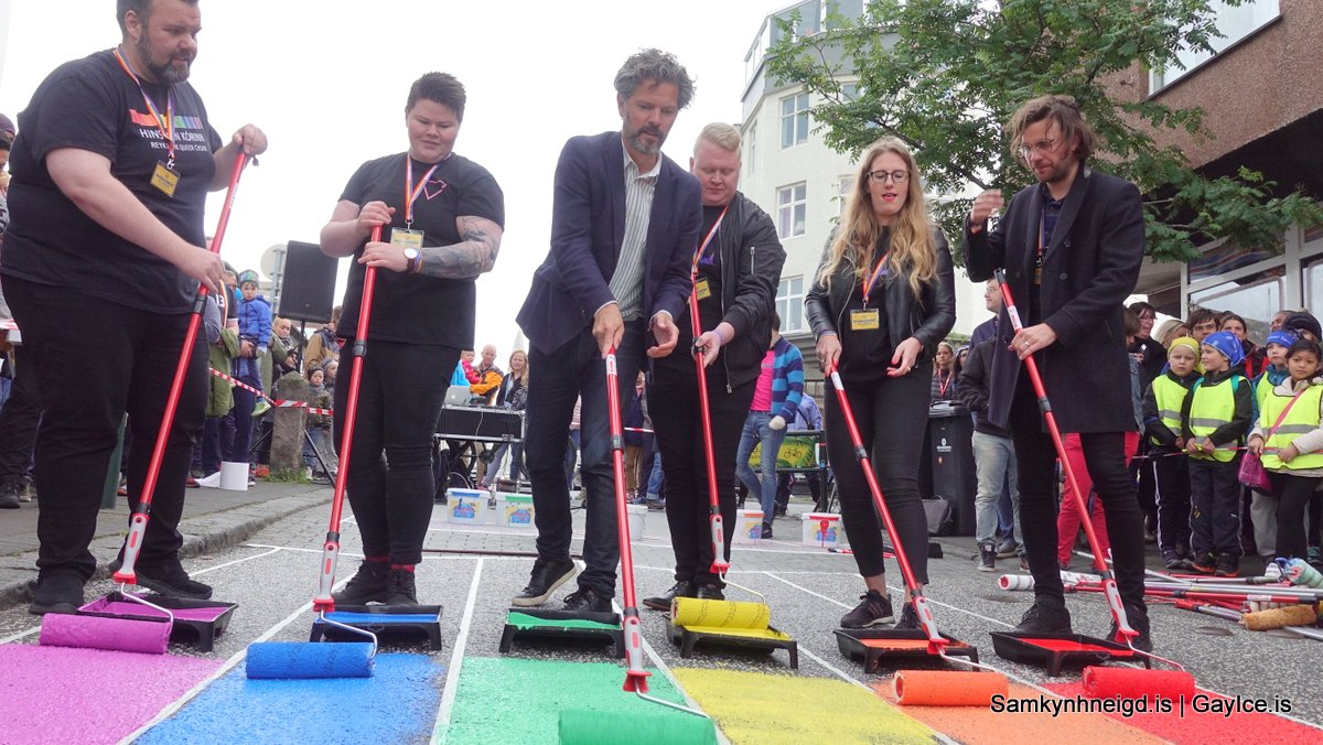 The mayor of Reykjavik paints a street in the colors of Pride